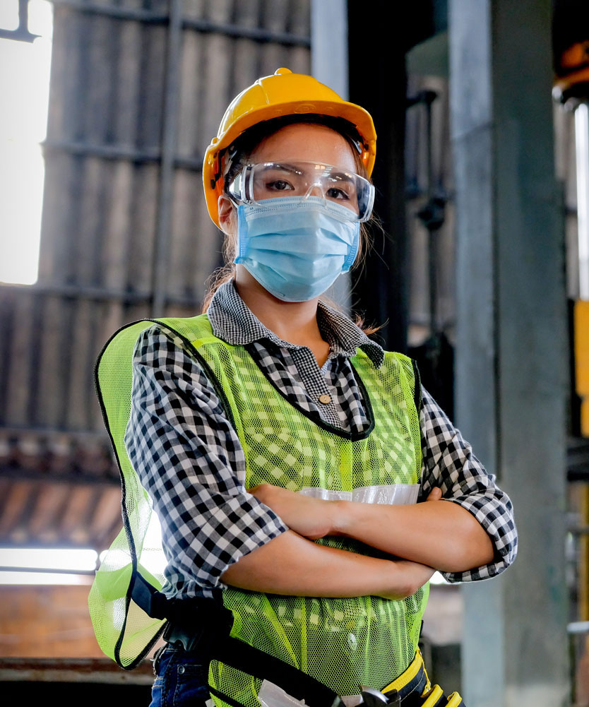 Manufacturing worker wearing a face mask.